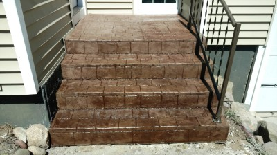 cobble stone stamped concrete steps with rail Plainwell