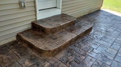 brown ashlar slate stamped concrete patio and step