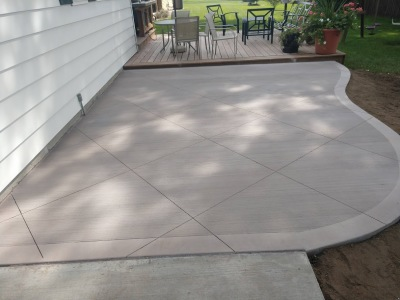 colored concrete patio with diamond saw cuts