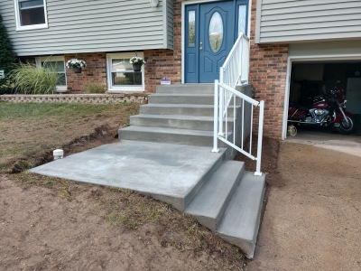 concrete steps with rails